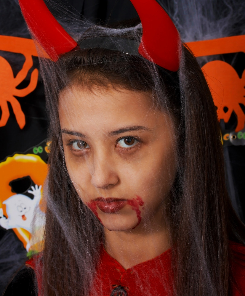 Girl Dressed Up As A Devil