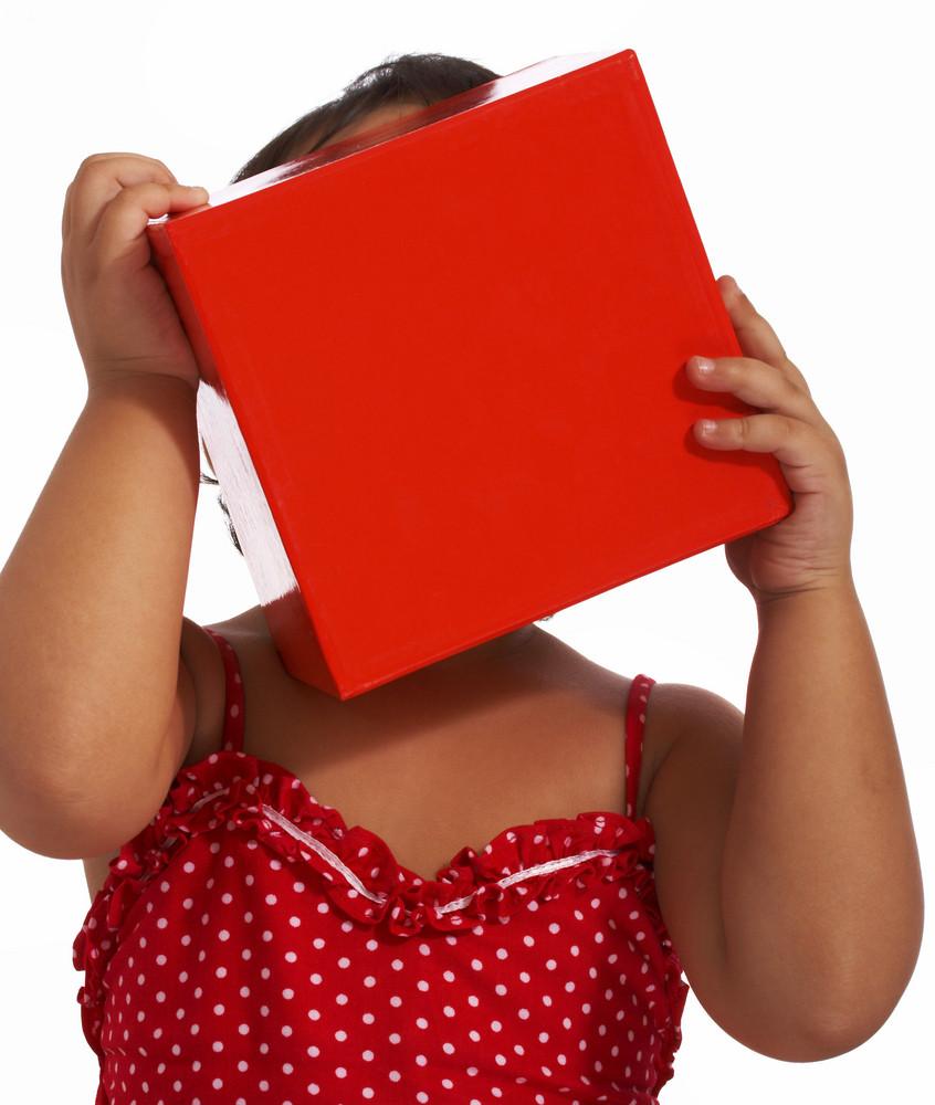 Girl Hiding Behind A Gift Box