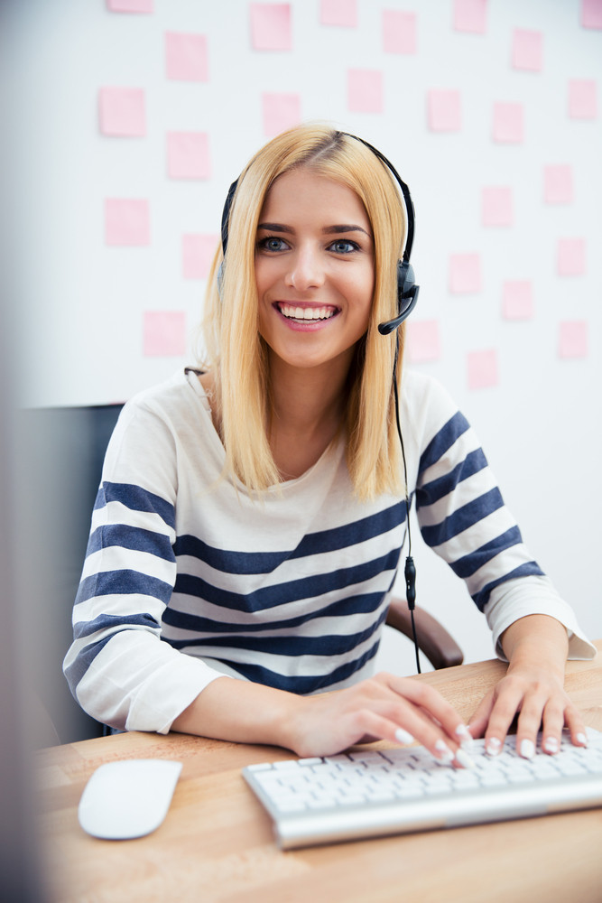 Girl in headset using computer
