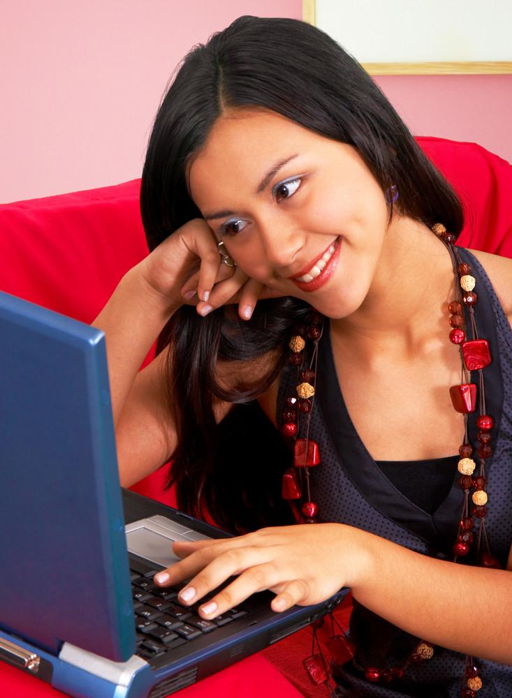 Girl In Living Room Using Her Laptop