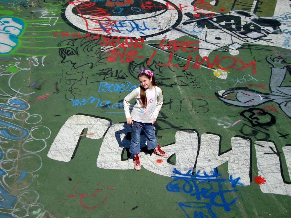 Girl In Skateboard Park