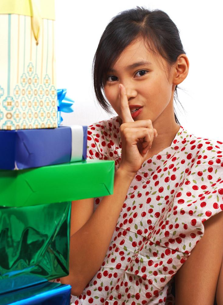 Girl Looking At Lots Of Birthday Presents