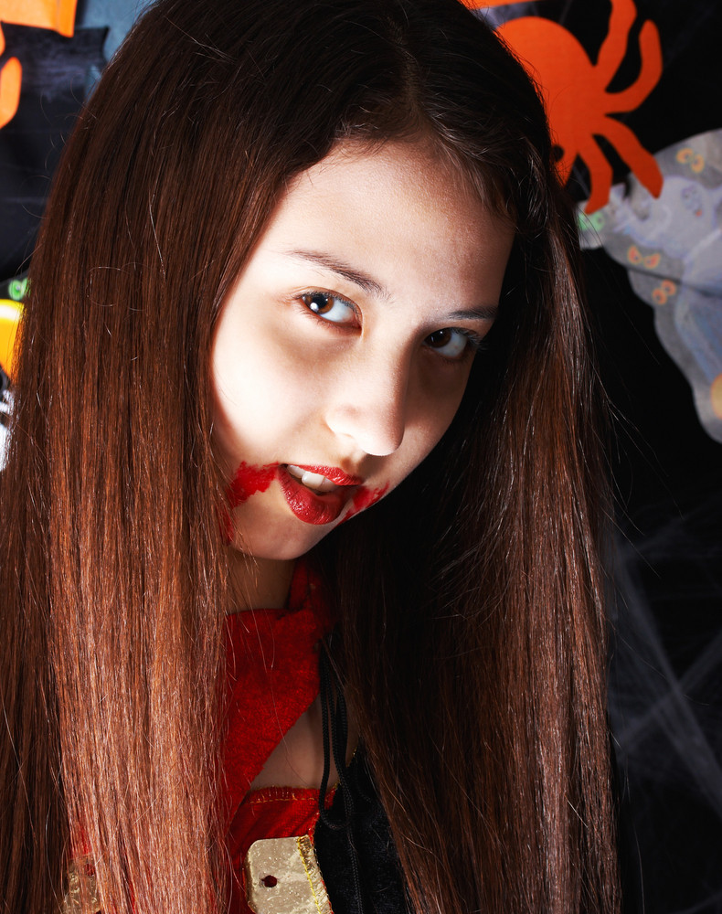 Girl Made Up As A Vampire At Halloween