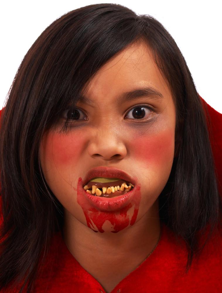 Girl Made Up As A Vampire At Halloween