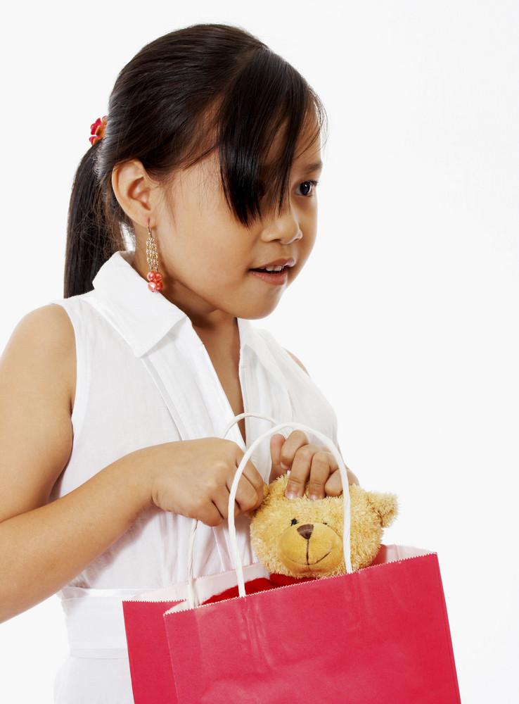 Girl Receiving A Birthday Gift