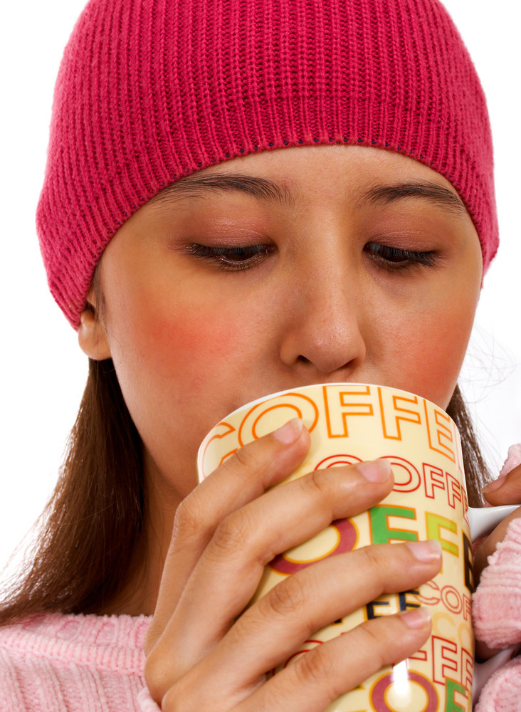 Girl Warming Herself With A Cup Of Coffee