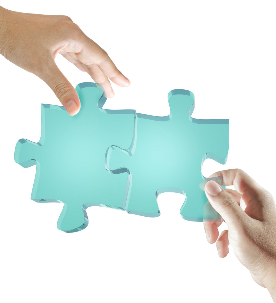 Glass Puzzles In Business Hands