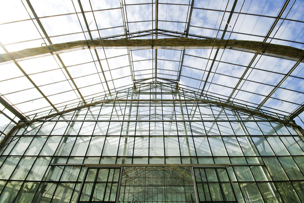 Glass roof with cloud and blue sky