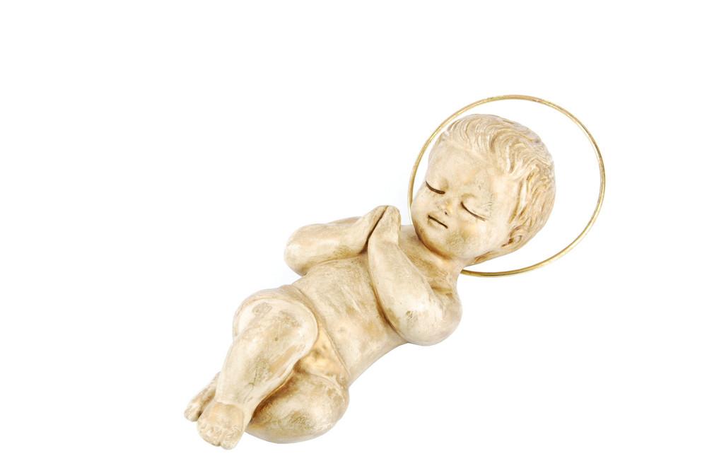 Golden Baby Jesus Lying On White