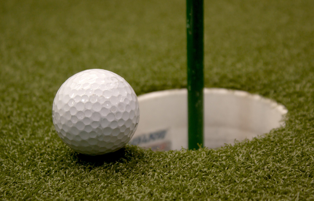 Golf Ball Going Into Cup