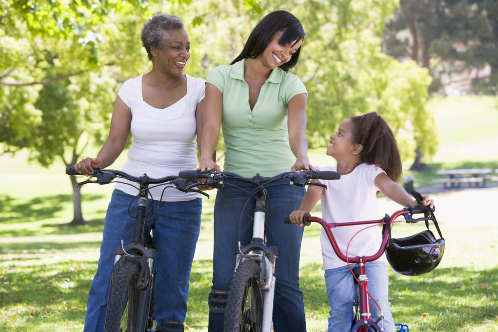 Grandmother mother and granddaughter bike riding