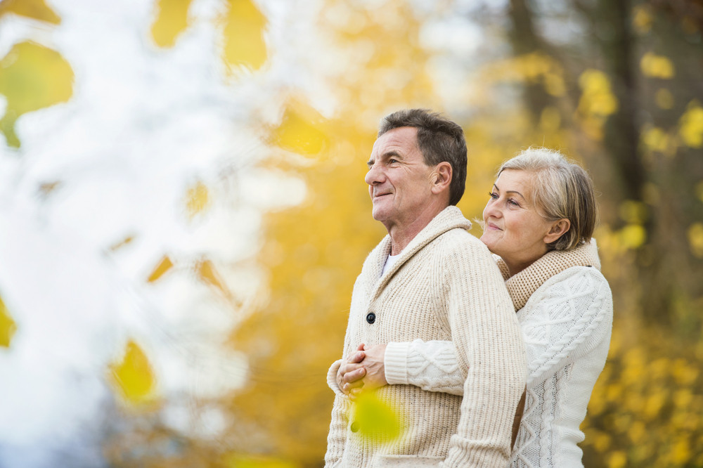 Active seniors having fun and relaxing in nature