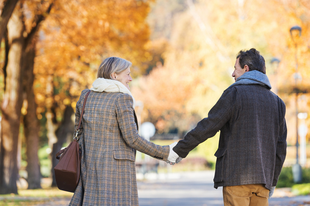 Active seniors on a walk in autumn town