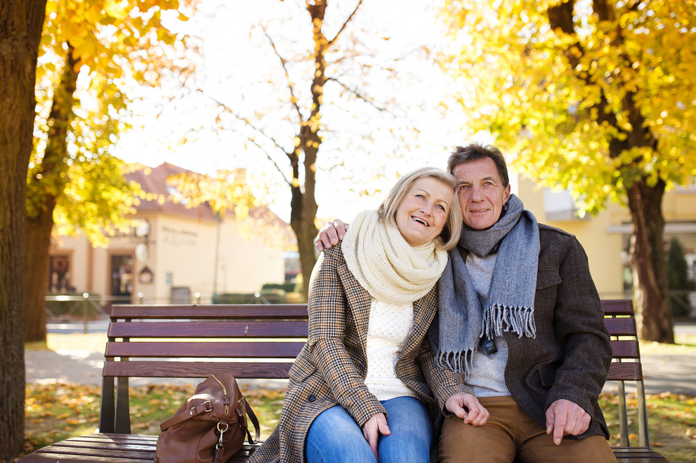 Superb Active Seniors Sitting On Wooden Bench In Autumn Town Bralicious Painted Fabric Chair Ideas Braliciousco