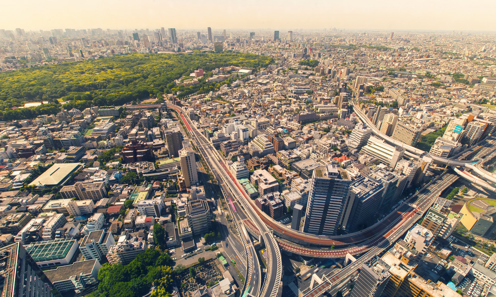 Aerial view time-lapse of a massive highway intersection during morning rush hour Shinjuku, Tokyo, Japan