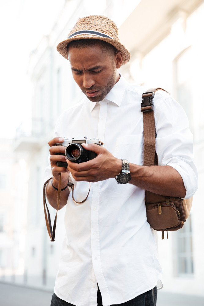 Afro american with camera. on the street