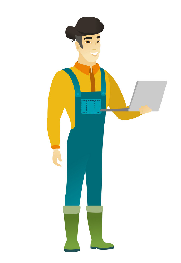 Asian farmer in coveralls using a laptop. Full length of young smiling farmer working on a laptop. Cheerful farmer holding a laptop. Vector flat design illustration isolated on white background.