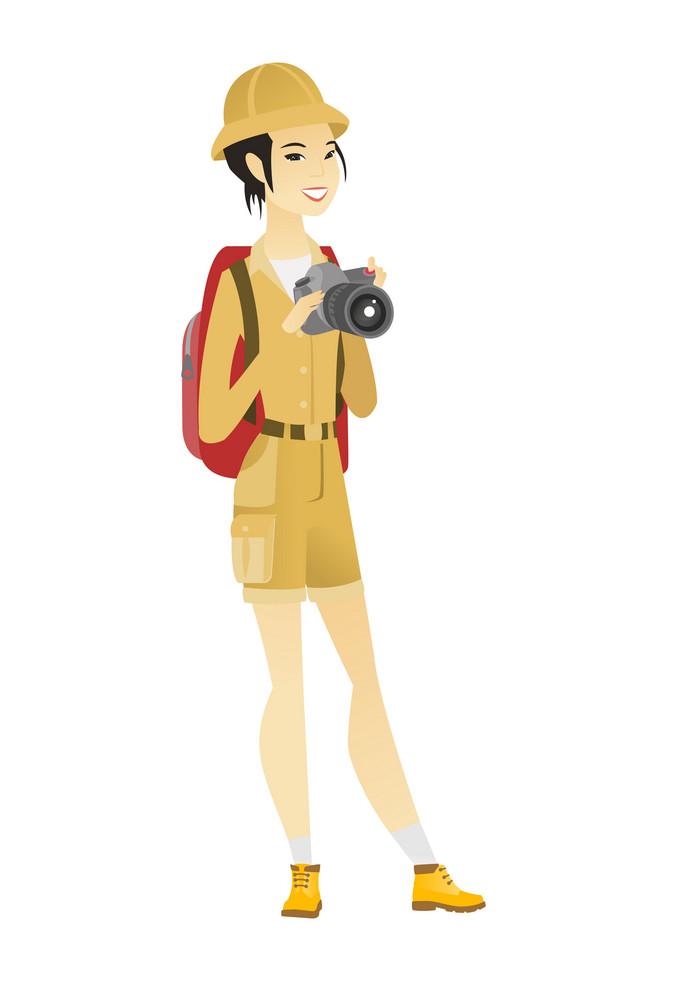 Asian nature photographer with digital camera. Travel photographer with digital camera making photo. Woman traveler with digital camera. Vector flat design illustration isolated on white background.