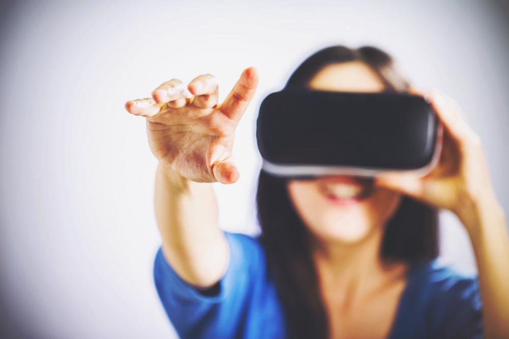 Asian woman using a new virtual reality headset