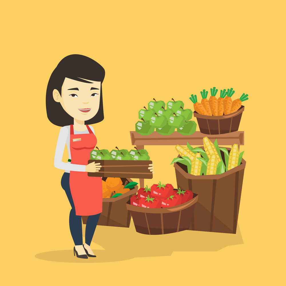 Asian worker of grocery store standing in front of section with vegetables and fruits. Female worker of grocery store holding a box with apples. Vector flat design illustration. Square layout.
