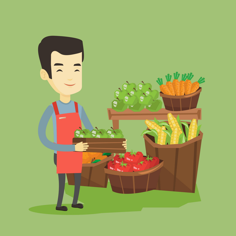 Asian worker of grocery store standing in front of section with vegetables and fruits. Young worker of grocery store holding a box with apples. Vector flat design illustration. Square layout.