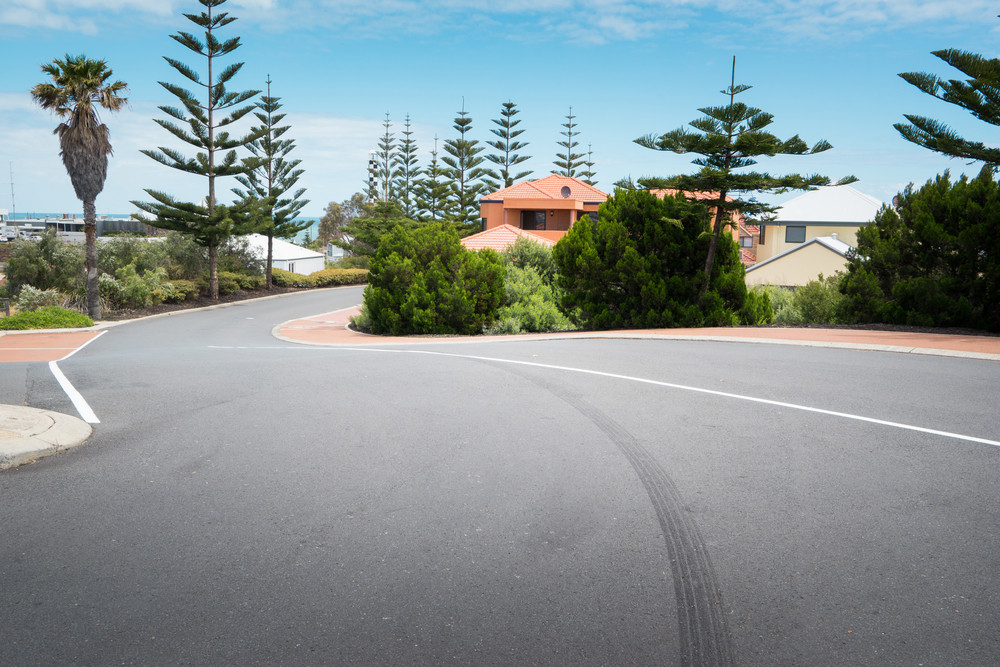 Asphalt road at the little coastal town of Myalup near Bunbury Western Australia .