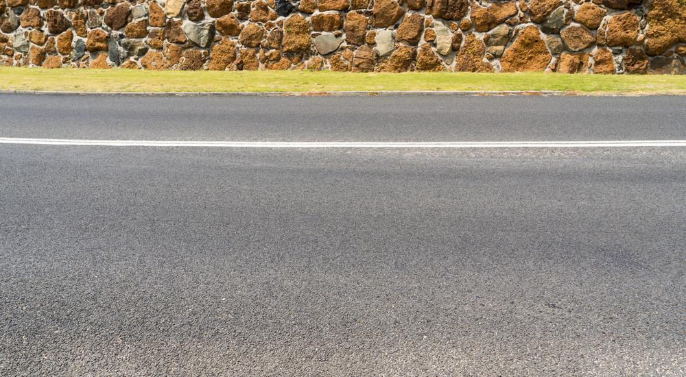 Asphalt road the at little coastal town of Myalup near Bunbury Western Australia .