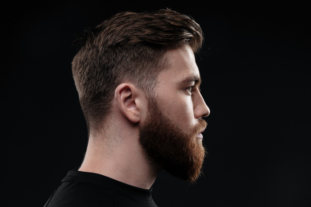 Athletic man in profile. isolated dark background