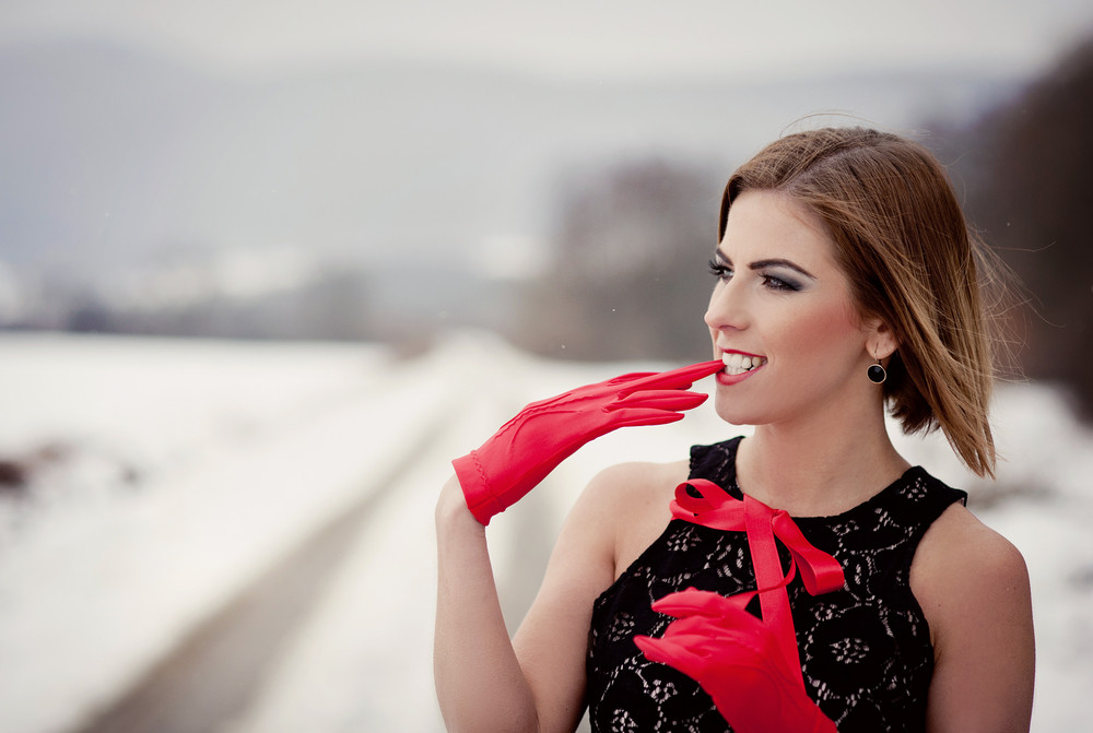 Attractive model in fashion dress in winter country