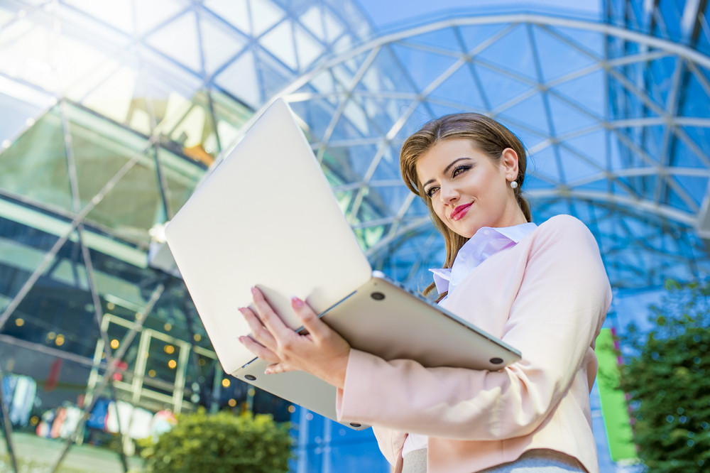 Attractive young business woman holding a notebook