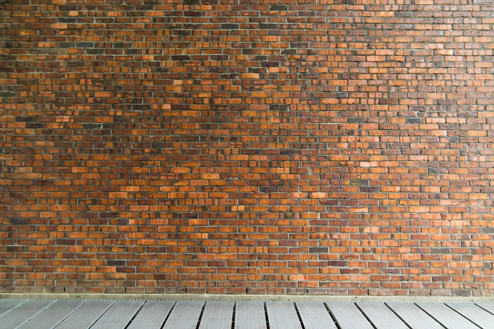 Background of old vintage brick wall with floor