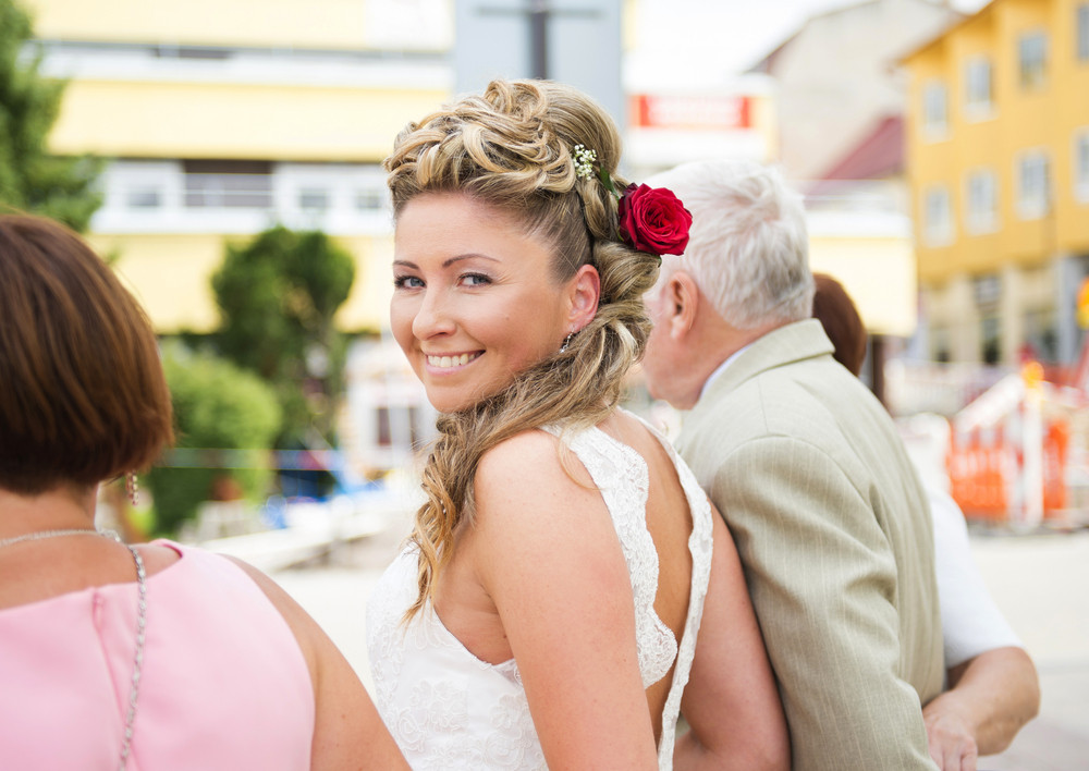 Beautiful bride outside the church with her parents