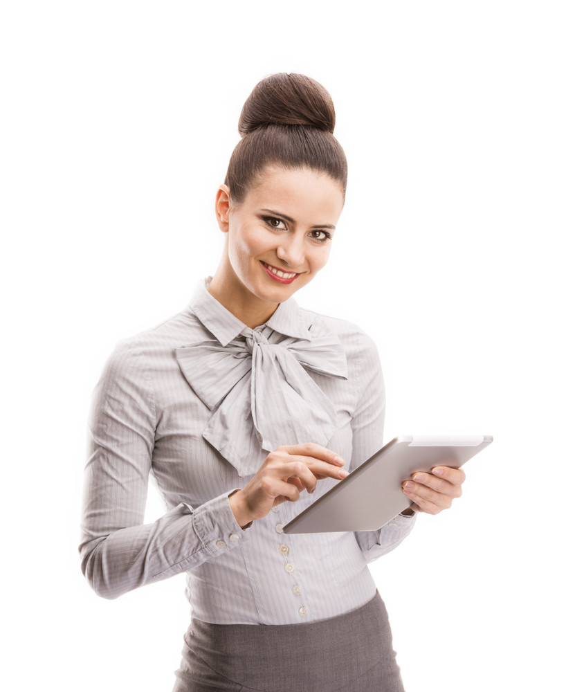 Beautiful business woman with digital tablet isolated over white background.