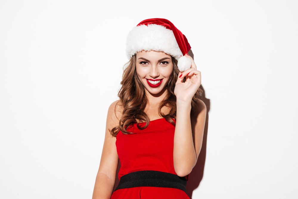 Beautiful christmas woman over white background. Close up and looking at the camera