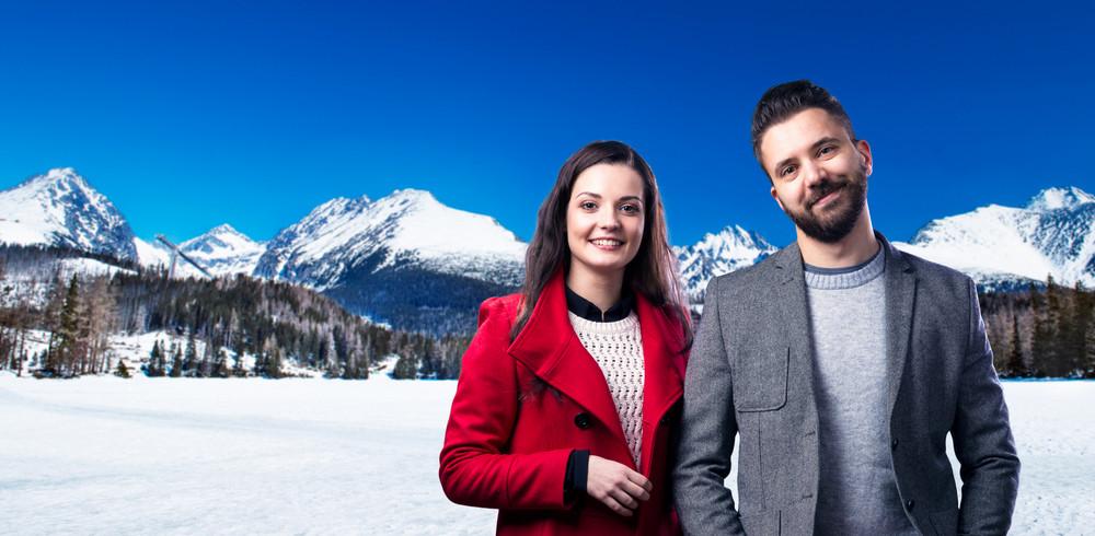 Beautiful couple enjoying a walk in mountains