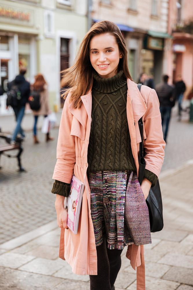Beautiful fashion model in coat. on the street