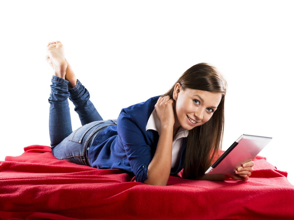 Beautiful girl with tablet is isolated in her room