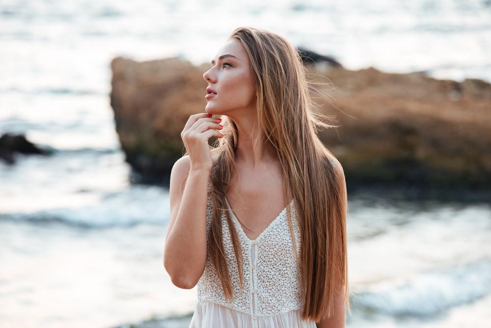Beautiful model on the beach. in profile
