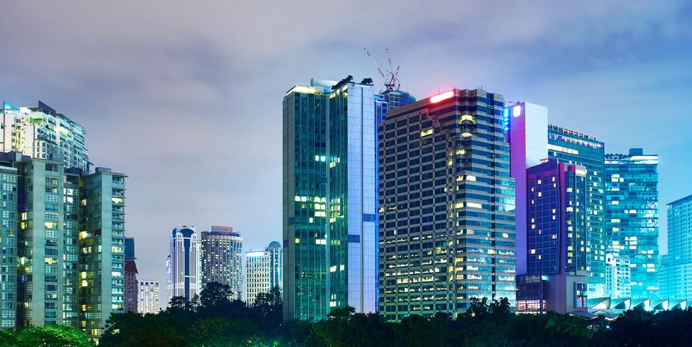beautiful night view of modern buildings in kuala lumpur