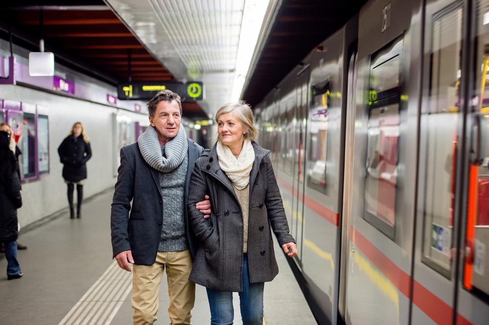 Beautiful senior couple at the underground platform, waiting