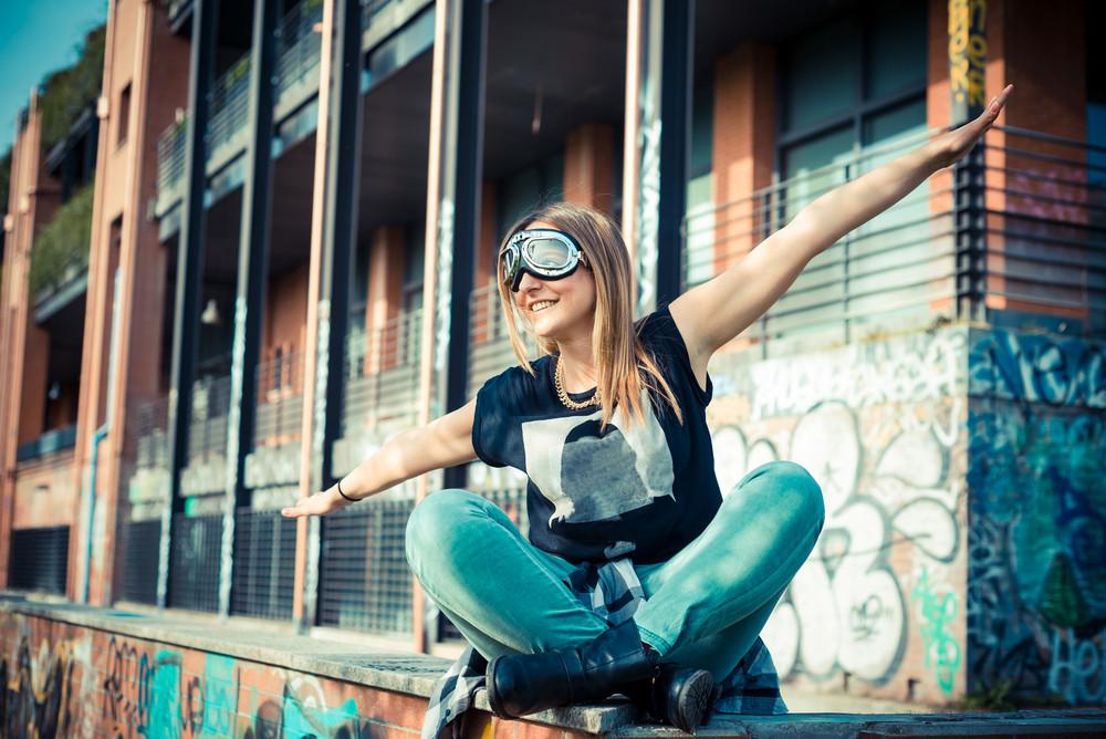 beautiful success aviator woman in the city