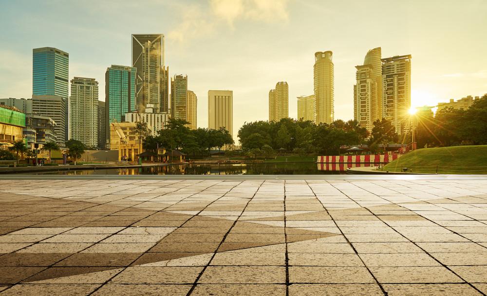 beautiful sunrise view of modern buildings in kuala lumpur with empty floor