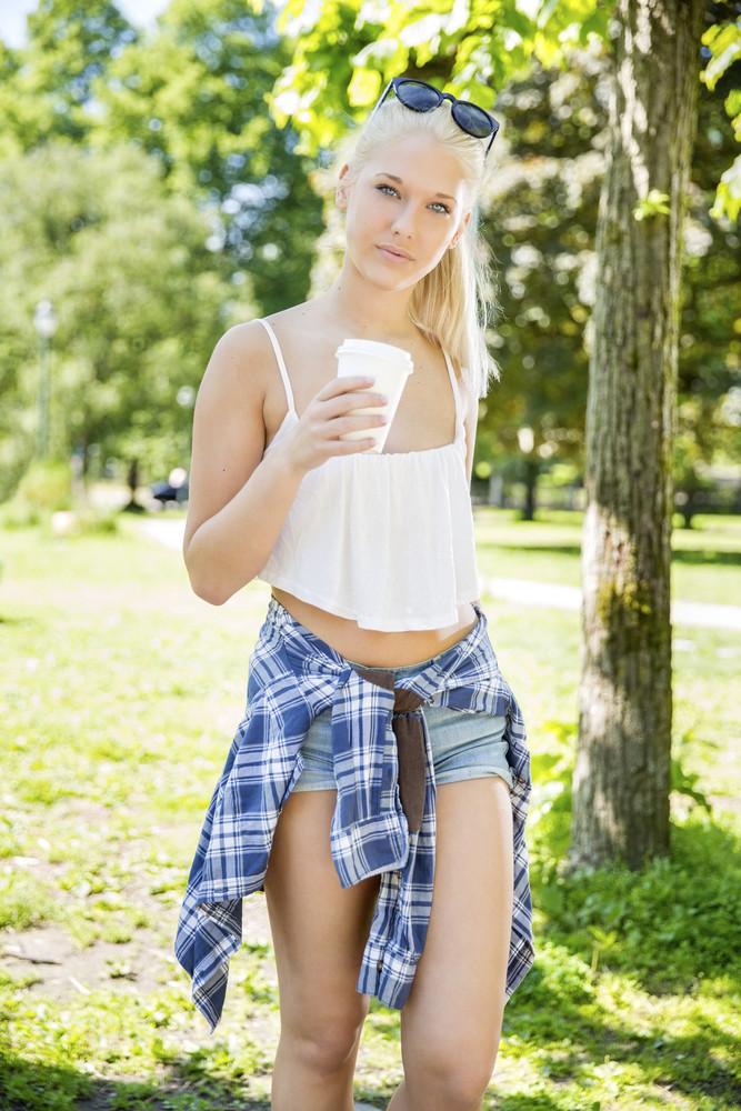 e999ea3fe1fc Beautiful teenage girl drinking coffee in park Royalty-Free Stock ...