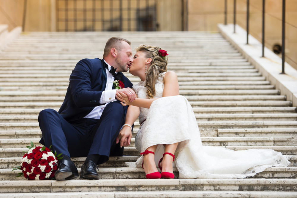 Beautiful wedding couple outside the castle on the stairs