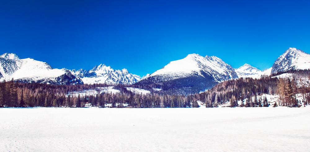 Beautiful winter mountain landscape with sun. High Tatras, Slovakia.