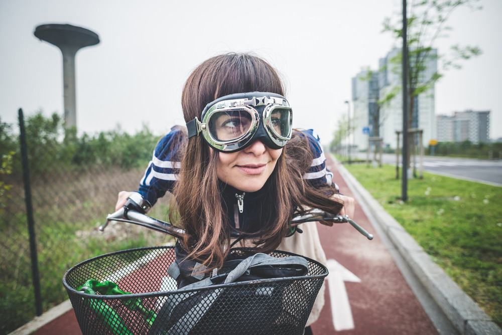 beautiful woman biker cycling in a desolate lurban landscape