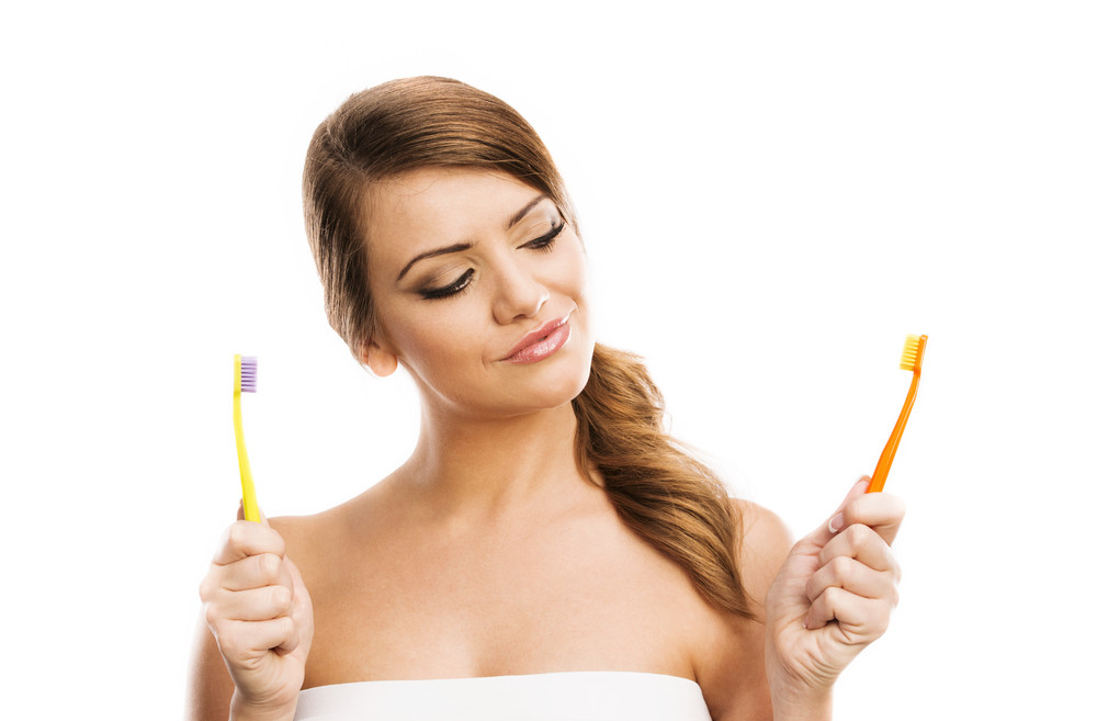 Beautiful woman with toothbrush. Dental care portrait. Isolated on white background.