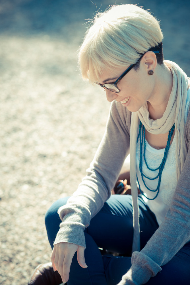 beautiful young blonde short hair hipster woman in the city