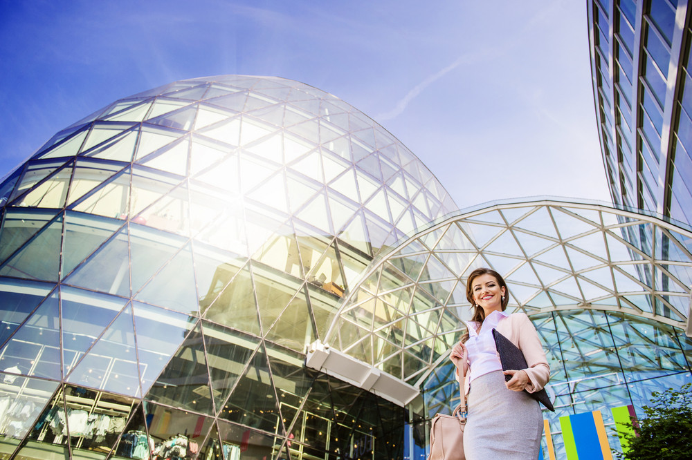 Beautiful young business woman outside a modern building