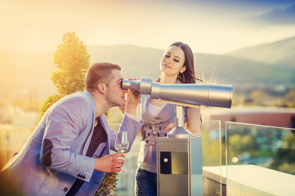 Beautiful young couple in love at the top of the building